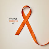 Orange ribbon and text multiple sclerosis day. The text multiple sclerosis day and an orange ribbon on a beige background royalty free stock photos