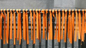 Orange Ribbons. Hanging from a New York City church, symbolizing prayers against gun violence Royalty Free Stock Images