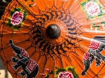 Orange rice paper umbrella dried in nature. Stock Images