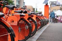 Orange ride sharing bicycles stock photo