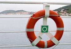 Orange Ring Lifebelt. Detail of lifebelt and ship's fence on the large cruiser Stock Photo