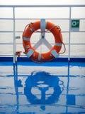 Orange ring lifebuoy on ferry boat deck.  Stock Image