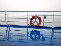 Orange ring lifebuoy on ferry boat deck.  Royalty Free Stock Photos
