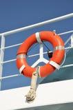 Orange ring lifebuoy. Lifebuoy hanging on protect bars of a ferryboat royalty free stock images
