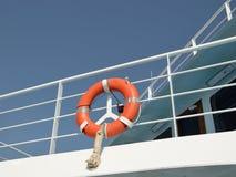 Orange ring lifebuoy. Lifebuoy hanging on protect bars of a ferryboat Stock Photography