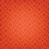 Orange rings on brown background Royalty Free Stock Photography