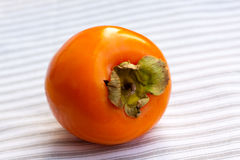 Orange ripe persimmon isolated Stock Images