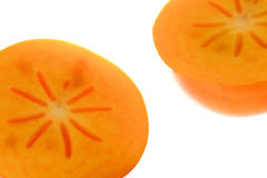 Orange ripe persimmon isolated over white backgrou Royalty Free Stock Image