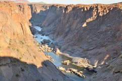 Orange River gorge, cut through granite, Augrabies Falls National Park , South Africa. The Orange river has cut a deep gorge through the ancient granites in the Stock Images