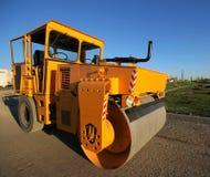 Orange road-roller Royalty Free Stock Photos