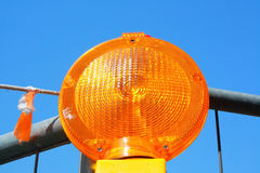 Orange road warning sign Stock Photo