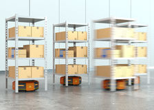 Orange robots carrying pallets with goods in modern warehouse Stock Photo