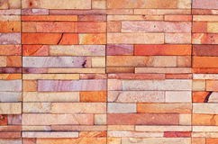Orange rock brick wall texture Stock Images