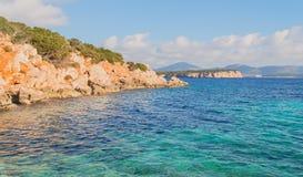 Free Orange Rocks In Cala Dragunara Royalty Free Stock Photography - 49027747