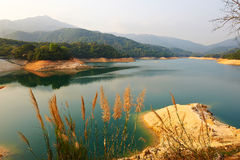 The orange rocks and lake water Stock Photos