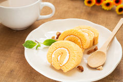 Orange roll cake and coffee cup Royalty Free Stock Photography