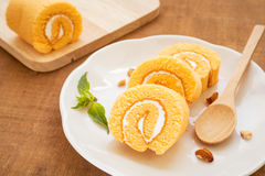 Orange roll cake on plate Royalty Free Stock Photography