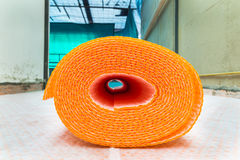 Orange roll of membrane waterproofing, separation and steam escape.  Drainage system for floor of terrace - roof. The sheath roll is resting on rolls already Stock Image