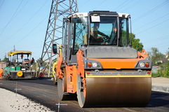 Orange rolling machinery making asphalt Royalty Free Stock Image
