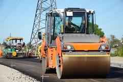 Orange rolling machinery making asphalt Royalty Free Stock Image