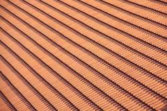 Orange roof tile pattern. Orange roof from carved tile, pattern of tile on the roof Stock Photos