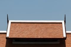 Orange roof tiles with blue sky background. It is Orange roof tiles with blue sky background Stock Photography