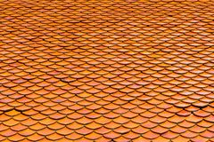 Orange roof tiles of Thai temple Royalty Free Stock Photo