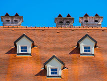 Orange roof with 3 windows Stock Photos