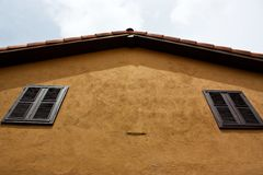 Orange roof of the yellow house Stock Images