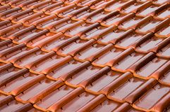 Orange Roofing Tiles. After a rain storm stock image