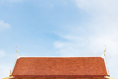 Orange roofs thai style  on blue sky. Background Royalty Free Stock Photography