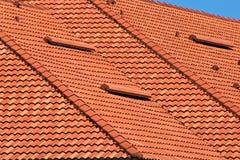 Orange rooftop detail. Close up image of orange roof tops showing zig zag pattern Stock Photos