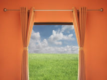 Orange room have a window with blinds you can see green Meadow a Stock Images