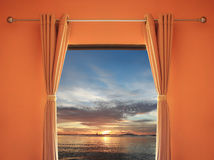 Orange room have a window with blinds you can see sunset in even Stock Photo