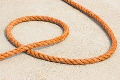 Orange rope on concrete in seaport Stock Photo