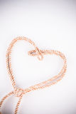 Orange rope in heart shape Stock Photo
