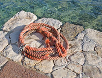 Orange rope on the pier Royalty Free Stock Photo