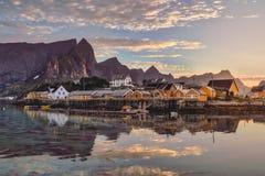 Orange rorbu houses at sunset royalty free stock photography