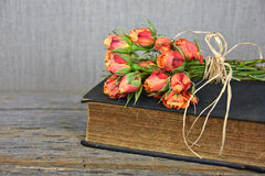 Orange rose bouquet on book Royalty Free Stock Photography