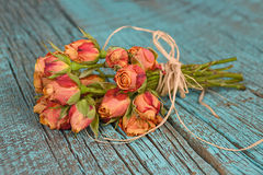 Orange rose bouquet on wood Stock Image