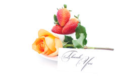 Orange rose , card with the words thank you and cup is