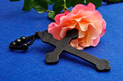 An orange rose and rosary beads. An orange rose with rosary beads stock photos
