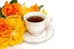 Orange rose and white cup Stock Photography