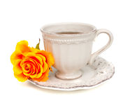 Orange rose and white cup Royalty Free Stock Photo