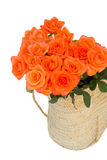 Orange roses in basket Royalty Free Stock Image