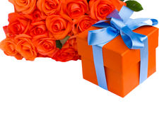 Orange roses with gift box Royalty Free Stock Images