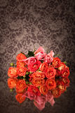 Orange roses on glass table with copy space Royalty Free Stock Images