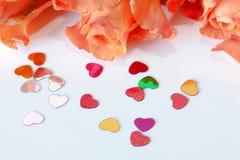 Orange roses and hearts Royalty Free Stock Photos