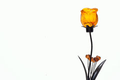 Orange roses are made of glass. The metal shaft stock photography