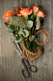 Orange roses and old scissors Royalty Free Stock Images